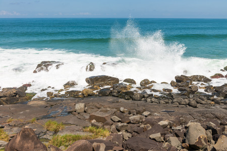 armacao: Rocks at the Armacao beach in Florianopolis, Santa Catarina, Brazil. One of the main tourists destination in south region.