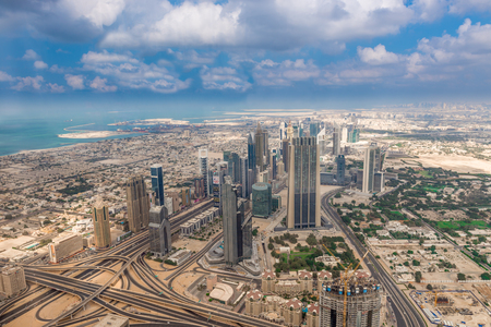 rd: Dubai, United Arab Emirates - Dec 2, 2014: Aerial shot of Sheik Zayed Rd with the  Financial Center Rd. Taken from the observation deck of the Burj Khalifa in Dubai, the worlds tallest building.
