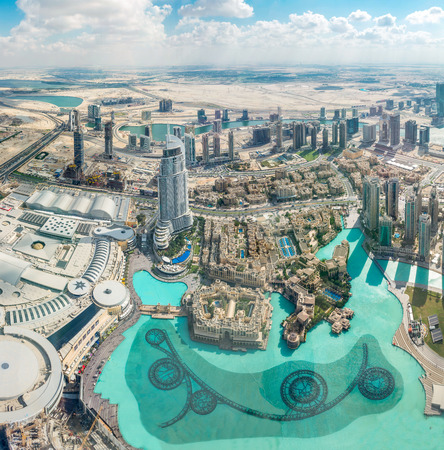 indefinitely: Dubai, United Arab Emirates - Dec 2, 2014: Aerial shot of Dubai including The Address hotel, which will be closed indefinitely after suffering extensive damage from the blaze on New Years Eve. Editorial