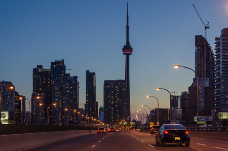 express lane: Toronto highway at night with cars. Toronto has a population of 6M and is the provincial capital of Ontario and the largest city in Canada. Stock Photo