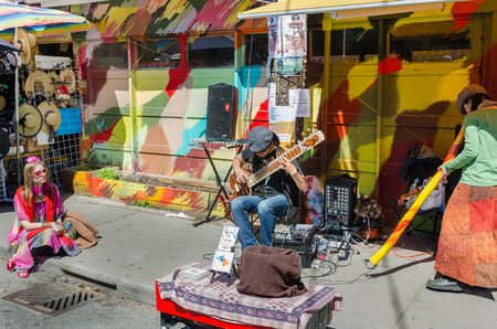 earned: Toronto, Canada - 26 may 2013:  Street artists play at Farmers Market in the new Pedestrian Sundays celebration. Kensington Market is a distinctive multicultural neighborhood in Downtown