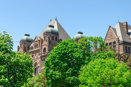 legislative: Toronto, Canada - 26 may 2013: Queens Park legislative buildings. It was designed by architect Richard A. Waite; its construction begun in 1886 and it was opened in 1893.