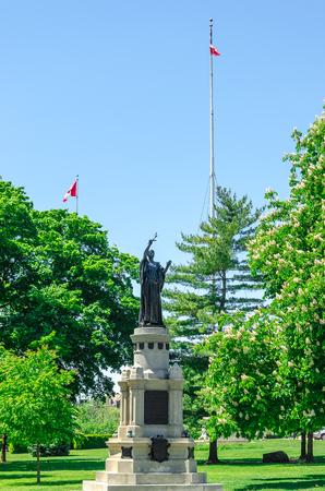 legislative: Toronto, Canada - 26 may 2013: Statue at the Queens Park legislative buildings garden. It was designed by architect Richard A. Waite; its construction begun in 1886.