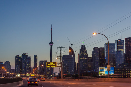 express lane: Toronto, Canada - 26 may 2013: Toronto highway at night with cars. Toronto has a population of 6M and is the provincial capital of Ontario and the largest city in Canada.