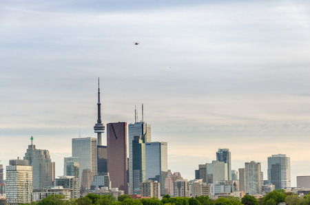 building cn tower: Toronto, Canada - 27 may 2013: Skyline of downtown Toronto, Canada, with Cn Tower in the spring from Riverdale Park East Editorial