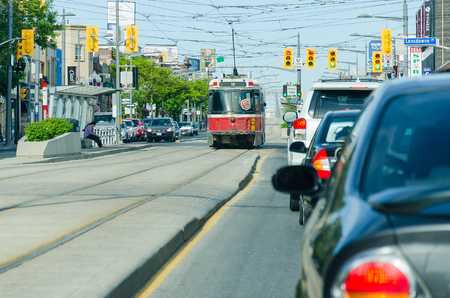 public market sign: Toronto, Canada - 27 may 2013:  Lansdowne ave in Chinatown showing city transportation streetcar. The TTC operates the third most heavily used urban mass transit system Editorial