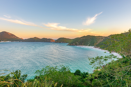 crystalline: Sunset at the  crystalline and turquoise beaches of Pontal do Atalaia, Arraial do Cabo, Rio de Janeiro, Brazil.