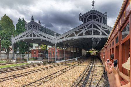 rei: Tiradentes, Brazil, Dec 30, 2015: Old May Smoke train parked at the station in Saint John Del Rei, a Colonial Unesco World Heritage city.