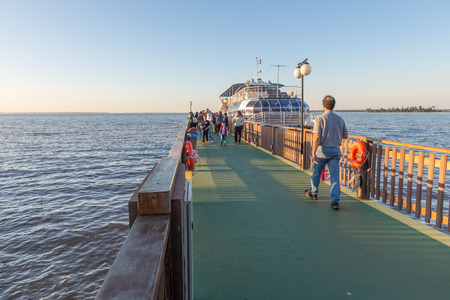 Foz do Iguacu, Brazil - july 10, 2016: Tourist ship boarding people and getting ready for a tour over the parana river in Itaipu dam park at the brazilian border.