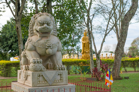 buddah: Chinese classical Buddah and stone lions in a Temple at the Foz do Iguazu, Brazil Stock Photo