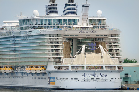 seas: Fort Lauderdale, Florida, USA - September 23, 2012: Close up of the back side of the biggest cruise ship, Allure of the Seas, docked in port of Fort Lauderdale Editorial