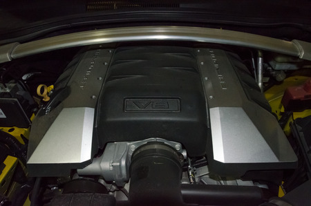 introduced: Miami, USA - September 22, 2012: The engine of a Chevrolet Camaro SS convertible. The fifth generation was introduced in 2010. This convertible SS features a 6.2L V8 producing 400HP.