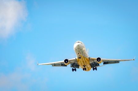 Miami, USA - october 4, 2012: Airplane approaching the airport and landing in a bright sky in Miami