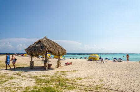seascapes: Aruba, Caribbean - September 26, 2012: View of Tourists enjoying  Baby beach on Aruba island in the Caribbean sea Editorial