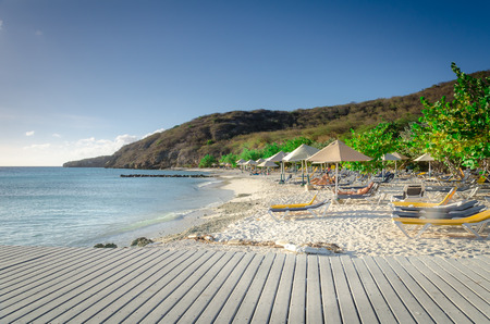 Curacao, Caribbean - october 1, 2012: Tourists enjoying the Porto Mari white sand Beach with blue sky and crystal clear blue water in Curacao, a Caribbean Island Editorial