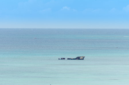 aground: aground ship in a blue caribbean sea in Aruba Island