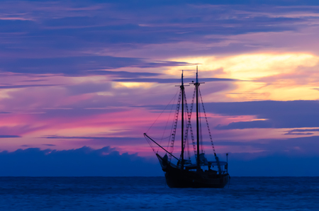 aruba: Pirate sailboat on sea navigating towards the sunset. The image was taken from Palm Beach in Aruba, in the Caribbean Sea.