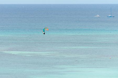 Para sailing in a blue caribbean sea in Aruba Island Stock Photo