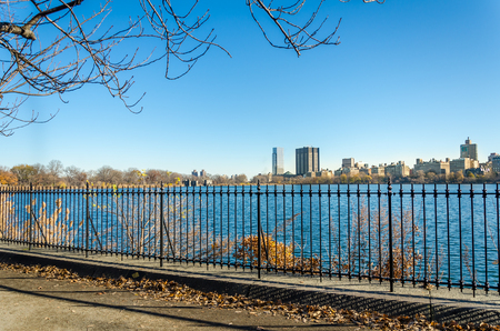 New York City Manhattan Central Park panorama in Autumn lake with fountain, skyscrapers and colorful trees Stock Photo