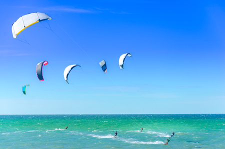 Beach in Cumbuco at the Ceara state with multiple kite surfing sport people Stock Photo