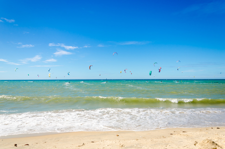 Several kite surfing on the air at the Cumbuco beach in Ceara
