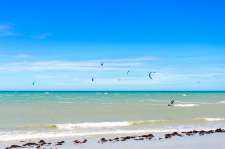 Many kite surfers enjoy their sport on a windy day in Cumbuco