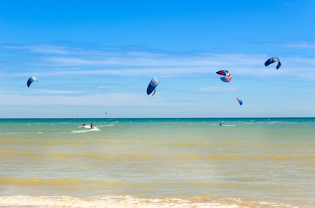 Cumbuco, Brazil, jul 9, 2017: People sailing on their kite board and enjoying the sea