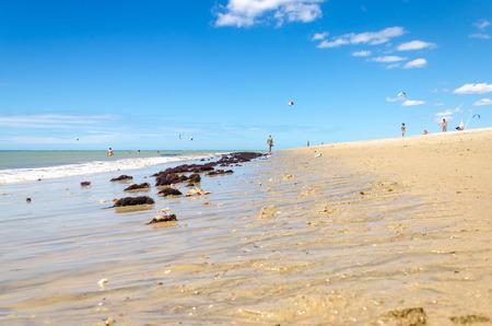 Cumbuco, Brazil, jul 9, 2017: photographer  looking for a good shot in Cumbuco beach in Brazil Editorial