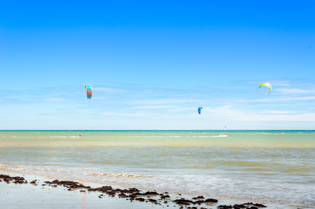 Cumbuco, Brazil, jul 9, 2017: Several kite surfing on the air at the Cumbuco beach in Ceara