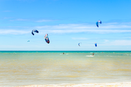 Cumbuco, Brazil, jul 9, 2017: Panoramic view with lots of people doing kitesurfing on the beach of Cumbuco