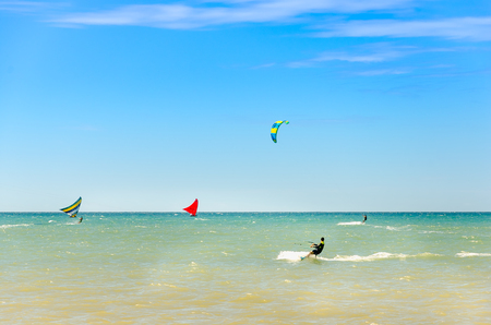 Cumbuco, Brazil, jul 9, 2017: The Jangada boat on the green sea water and blue sky background