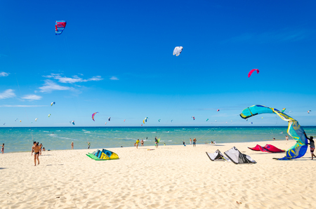 Cumbuco, Brazil, jul 9, 2017: Many kite surfers enjoy their sport on a windy day in Cumbuco