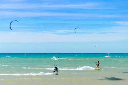 Cumbuco, Brazil, jul 9, 2017: Beach in Cumbuco at the Ceara state with multiple kite surfing sport people