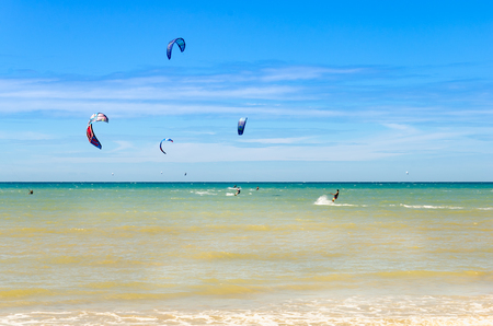 Cumbuco, Brazil, jul 9, 2017: Multiple sports man flying on their kite boarding by the sea