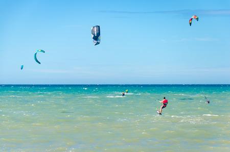 Cumbuco, Brazil, jul 9, 2017: Cumbuco white sand beach with many kitesurfers having fun