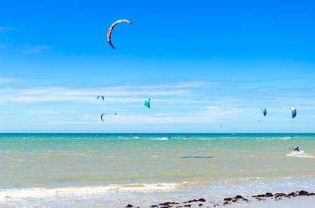 Cumbuco, Brazil, jul 9, 2017: Many kite surfers enjoy their sport on a windy day in Cumbuco