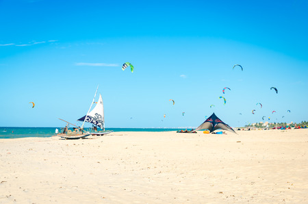 Cumbuco, Brazil, jul 9, 2017: Parked jangada boat over a paradise white sandy beach