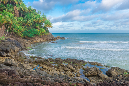 Amazing view of a rocky beach in nature at late afternoon Stock Photo