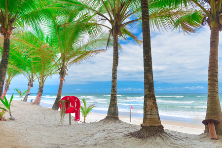 Itacare, Brazil - December 11, 2016: Beach and sea with Palm trees and a ring buoy lifeguard on the background Editorial