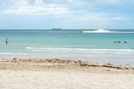 Miami, USA - jun 11, 2018: Tourists enjoying Miami south beach with storm approaching Redakční