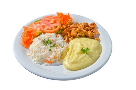 Tasty diced breast chicken garnished with rice, mashed potatos and salad. White isolated background