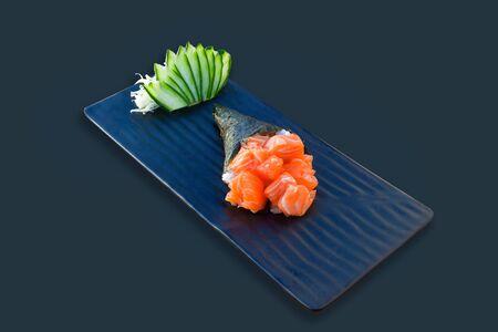 Temaki roll. Salmon sashimi flavour. Black background
