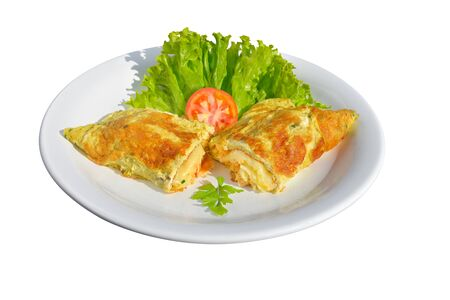 Rich omelet stuffed with melted cheese with side salad. White isolated background