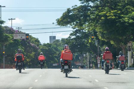 An outbreak of a pandemic disease. No cars at street at all, only bikers delivering food and packages across the city.