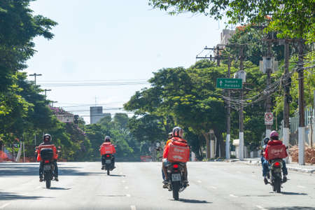 São Paulo, Brazil - april 5, 2020: An outbreak of a pandemic disease. No cars at street at all, only bikers delivering food and packages across the city. Redakční