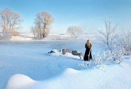 belarus: Frosty winter morning in Belarus, the girl about the frozen reservoir.