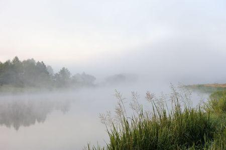 The sunrise, over the river rises a morning fog. photo