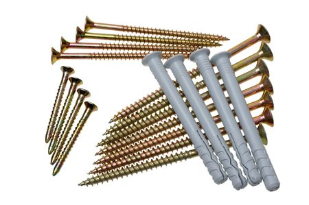A set of screws of various sizes on a white background photo