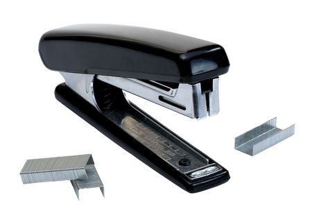 Black stapler and staples to him, isolated