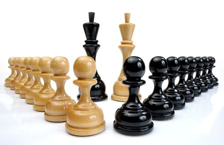 Several wooden chess pieces light and dark colors. photo